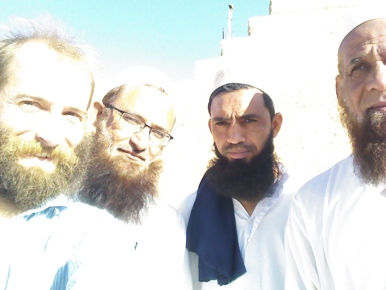 Stephen Matthews (left) with three Muslim gentlemen in Atar, Mauritania.