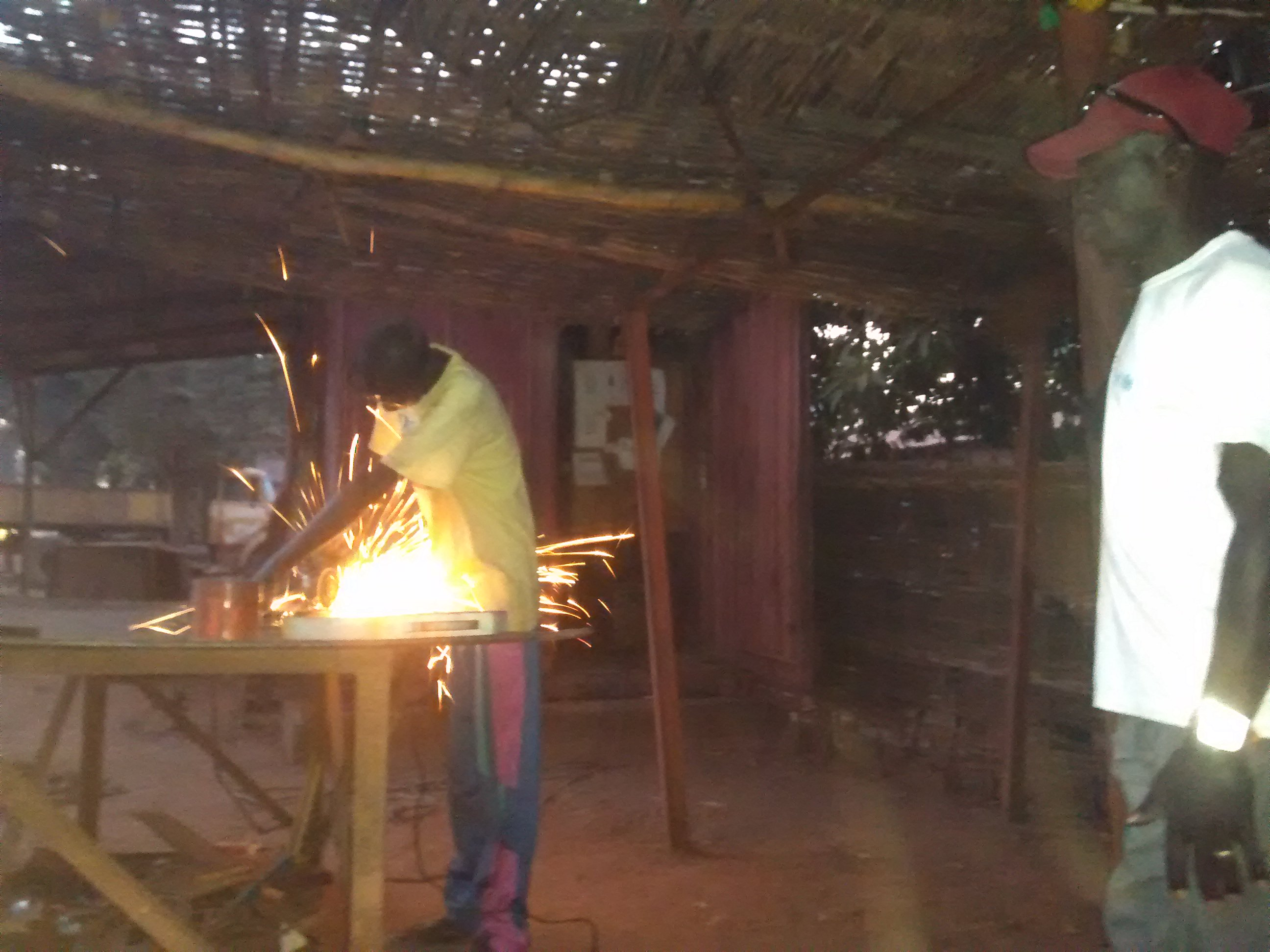 Blacksmith preparing patio mould for Couchsurfing friend, Lamine, in Sedhiou, Senegal.