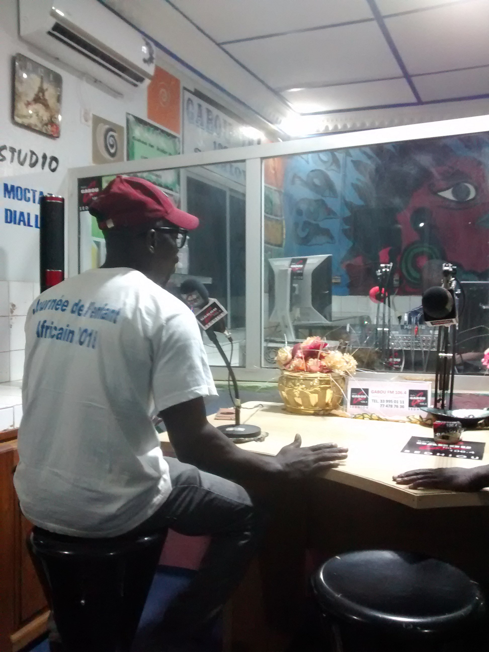 Couchsurfing friend, Lamine, performing comedian show on Gabou FM 106.4, Sedhiou, Senegal.