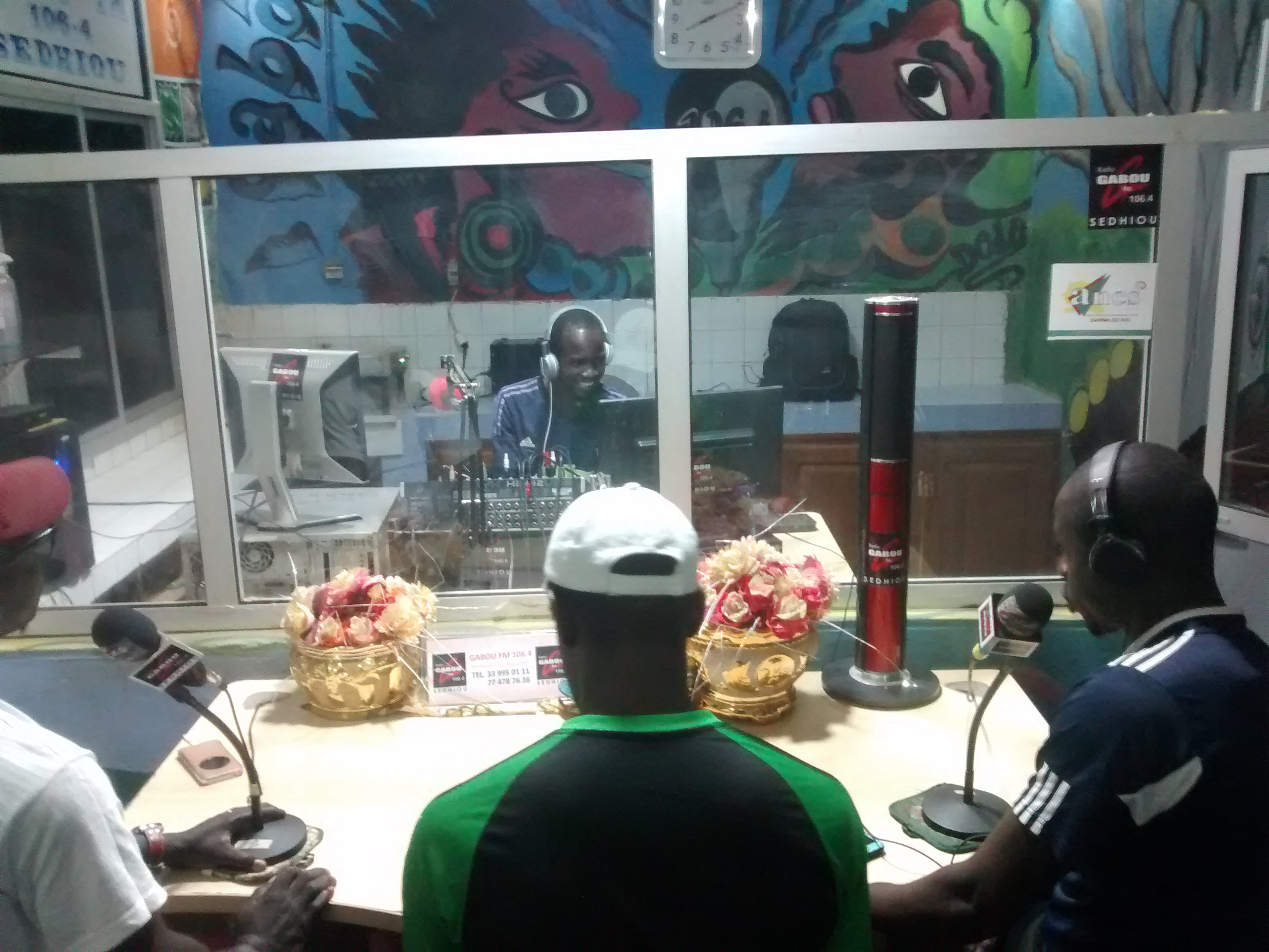 Couchsurfing friend, Lamine (left), performing comedian show with mates on Gabou FM 106.4, Sedhiou, Senegal.