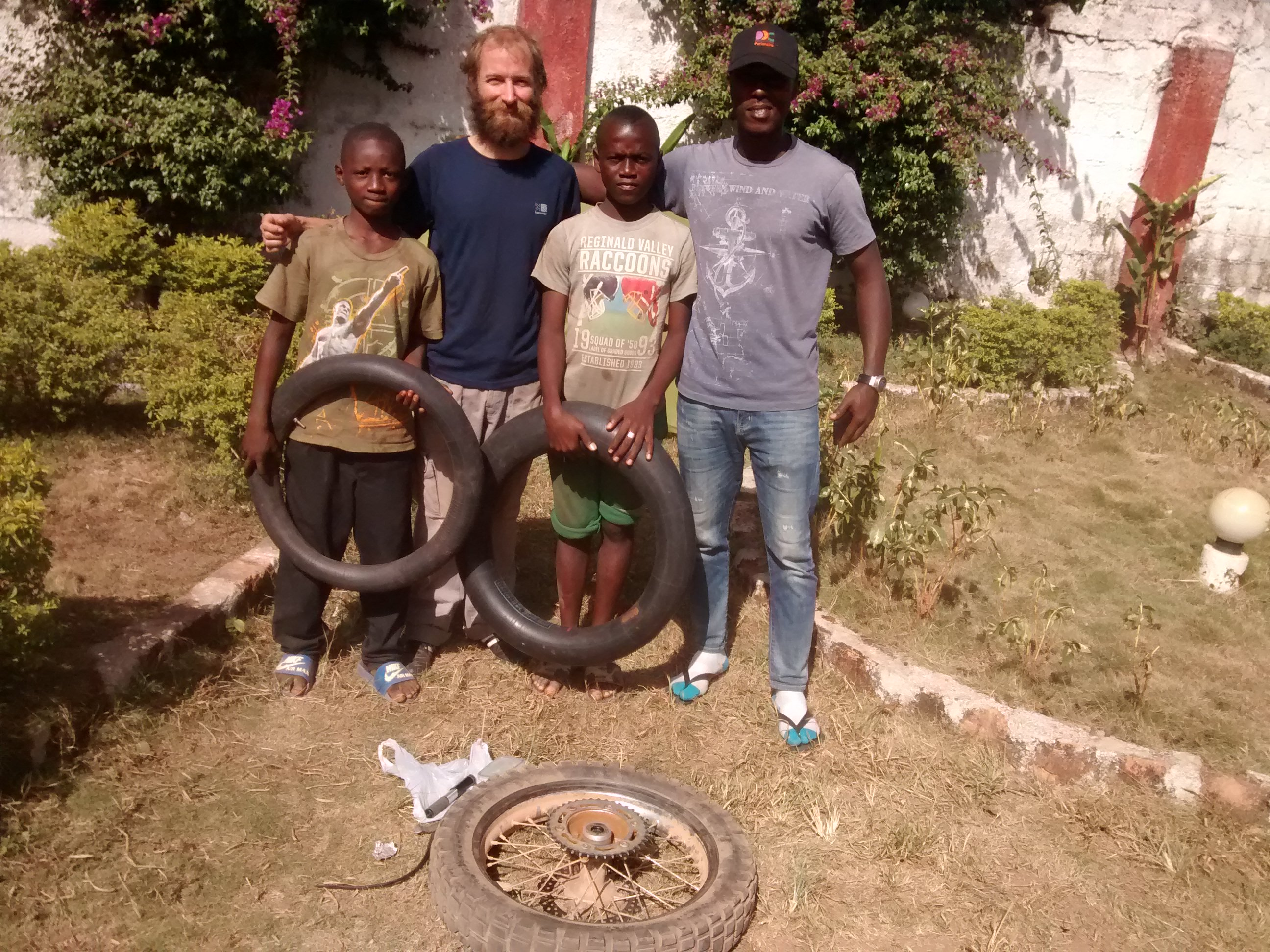 The people who helped fix my punctures and also purchase new inner tubes in Macenta, Guinea.