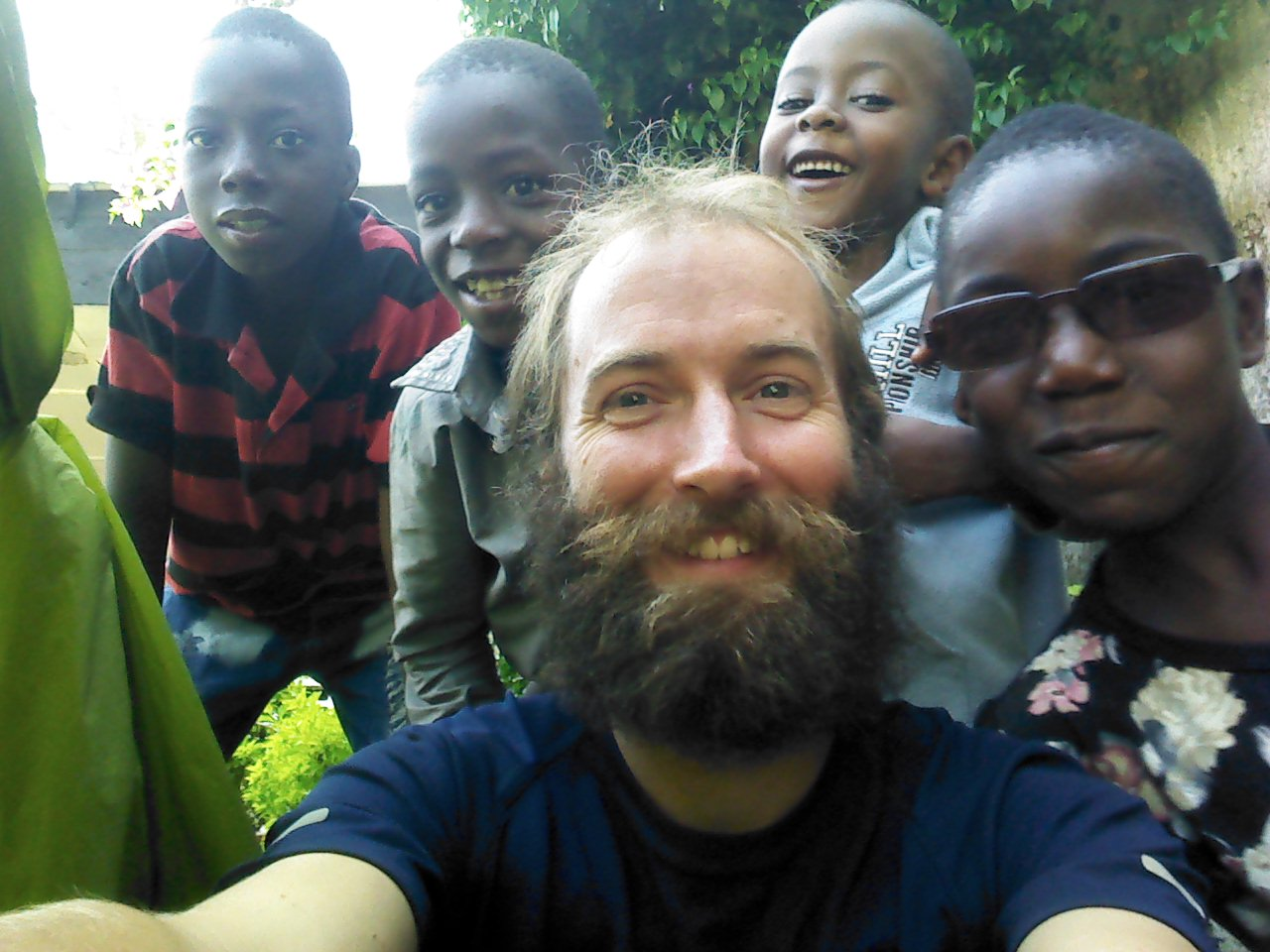 Kids intrigued by me and my tent, Macenta, Guinea.