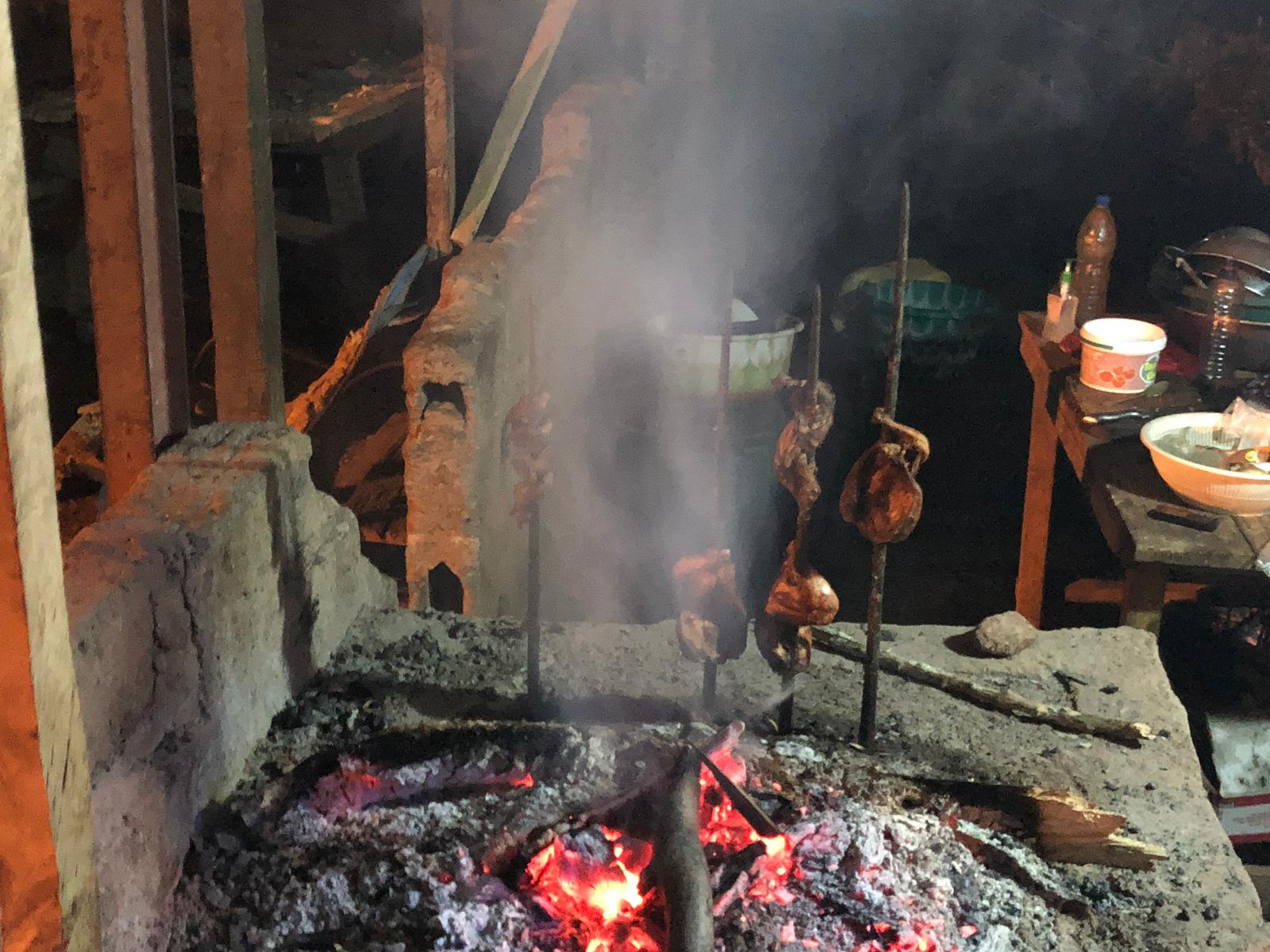 Chickens being barbequed for our dinner! Man, Guinea.