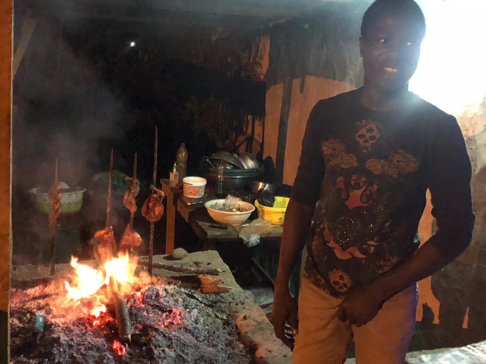 Chickens being barbequed for our dinner with one of the chefs! Man, Guinea.