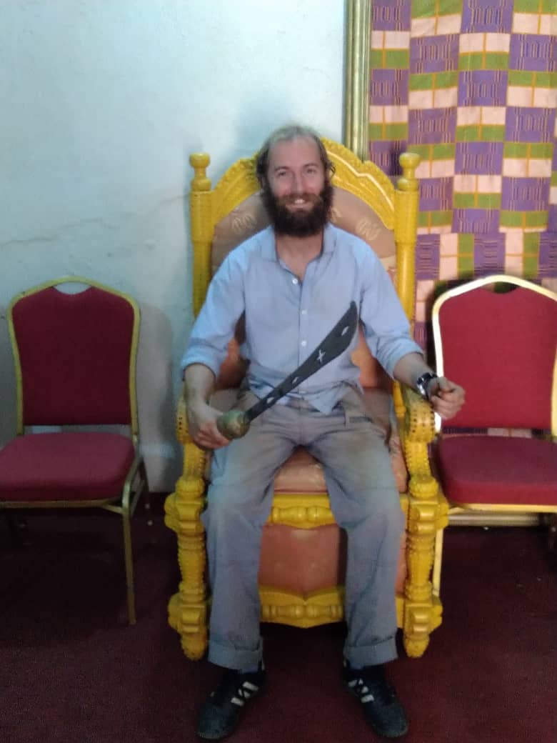 Cour Royal where the King of the Indénié resides. They ley me hold machete in the seat of someone important! Abengourour, Cote d'Ivoire.