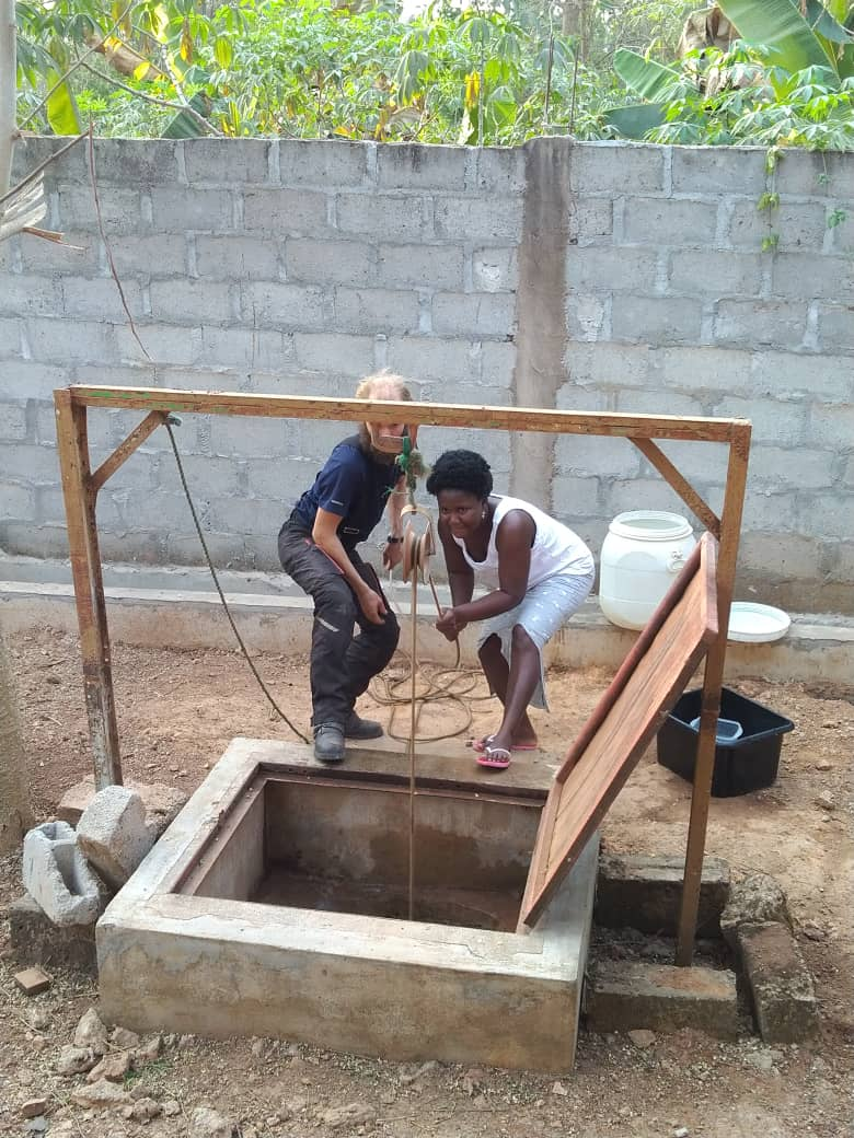 Helping Francine draw water from the well. Abengourou, Cote d'Ivoire..
