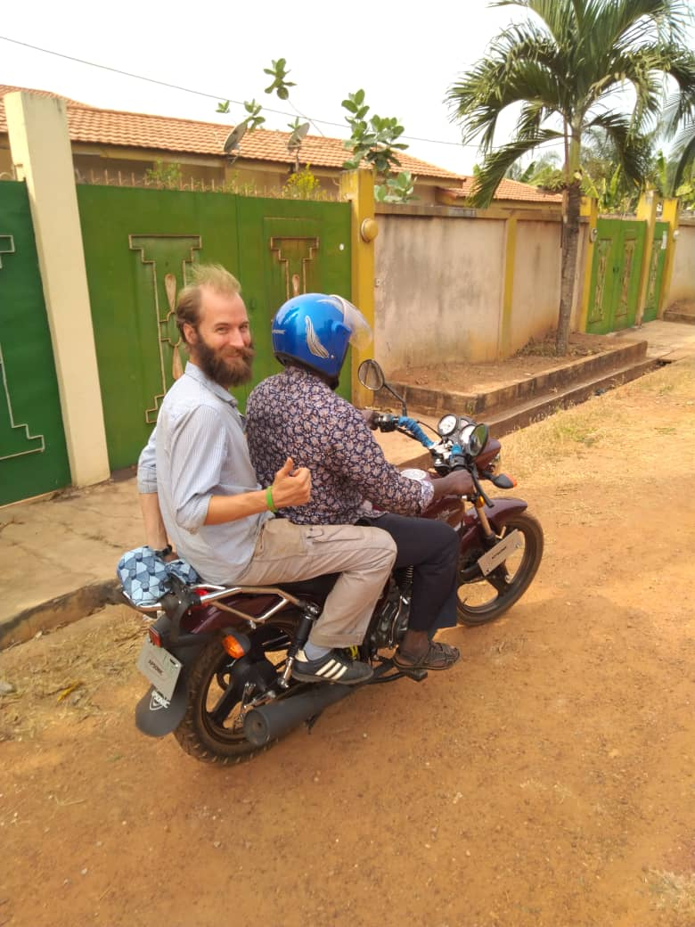 Getting a ride home from the restaurant with Chloe's brother, Ameliorer. Abengourou, Cote d'Ivoire.