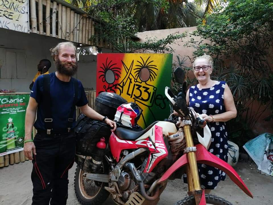 Chatting motorcycles at Dizzy Lizzie's, Ghana.
