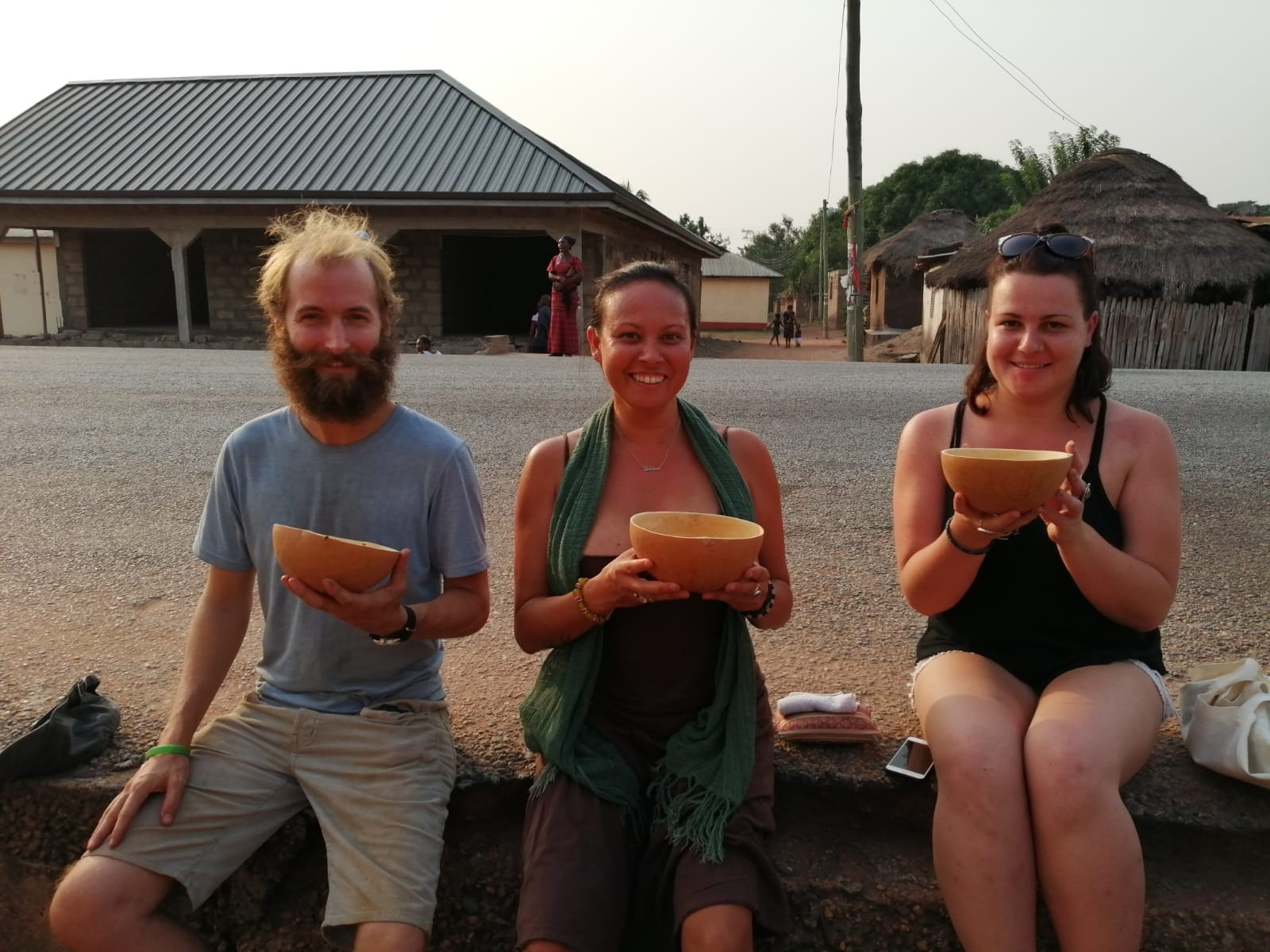 Enjoying palm wine in Frankadua, Ghana with Leela (middle) from @travellingbutterfly1 and Emily (right).